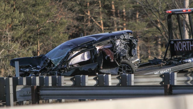 A flatbed truck removes an SUV involved in a three-vehicle crash Monday, March 19, 2018 on U.S. 127 in Lansing. Two people were taken to the hospital with serious, but non-life-threatening injuries.
