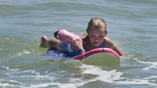A young tourist from out of state enjoys the water off Surf City.
