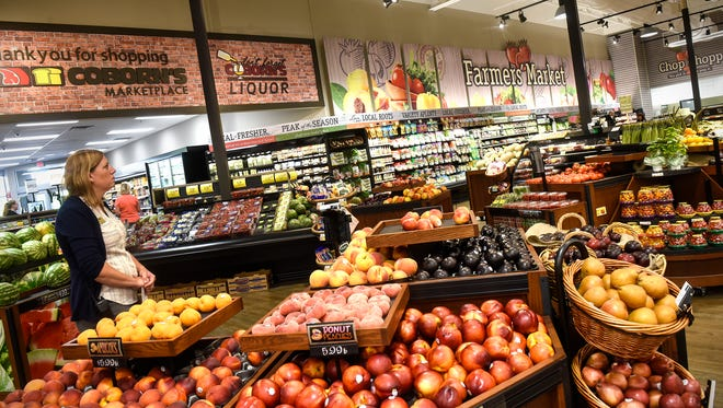 Store director Sarah Putnam talks about recently completed renovations in the fresh produce area Monday, July 16, at the Coborn's Marketplace on Cooper Ave. in St. Cloud.