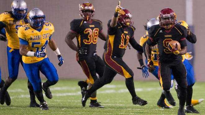 Tuskegee running back Hoderick Lowe (9) runs for a touchdown during the SIAC Championship between Tuskegee and Albany State on Saturday, Nov. 15, 2014, in Montgomery, Ala.