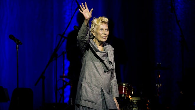 Joni Mitchell waves to the crowd during her 70th birthday tribute concert as part of the Luminato Festival at Massey Hall in Toronto on June 18, 2013. A woman identified as Mitchell's friend of more than 44 years, Leslie Morris, stated in a Tuesday, April 28, 2015, court filing in Los Angeles that the legendary folk singer is unconscious and unable to care for herself. A doctor's declaration accompanying Morris' petition to be named Mitchell's conservator states the singer-songwriter will not be able to attend any court hearings for at least four to six months, but offers no additional details on Mitchell's illness or prognosis.