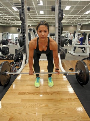 Personal trainer Robin Scott demonstrates how to do a deadlift with weights which focus on the full body work out at Lifetime Fitness in White Plains. Strength training will be one of the biggest fitness trends in 2015.