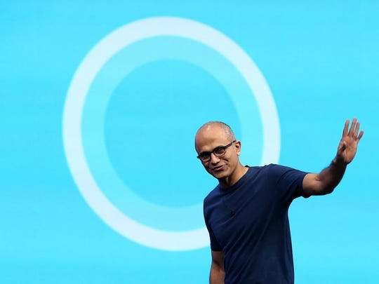 icrosoft CEO Satya Nadella walks in front of the new