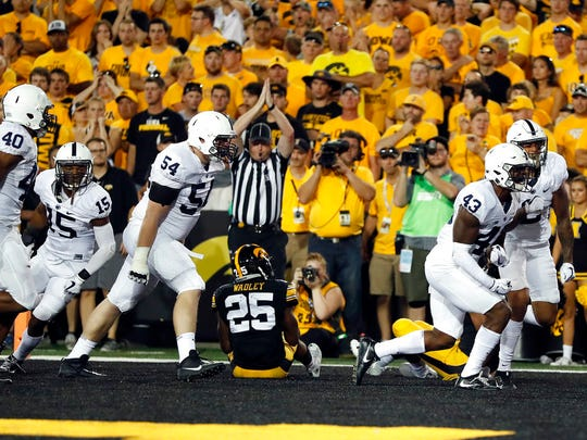 Penn State players celebrate after Iowa running back Akrum Wadley (25) was tackled in the end zone for a safety during the first half of an NCAA college football game Saturday, Sept. 23, 2017, in Iowa City, Iowa. (AP Photo/Jeff Roberson)
