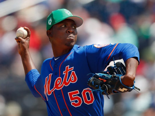 New York Mets pitcher Rafael Montero (50) works against the Washington Nationals in the third inning of a spring training baseball game, Saturday, March 17, 2018, in West Palm Beach, Fla.