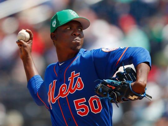 New York Mets pitcher Rafael Montero (50) works against