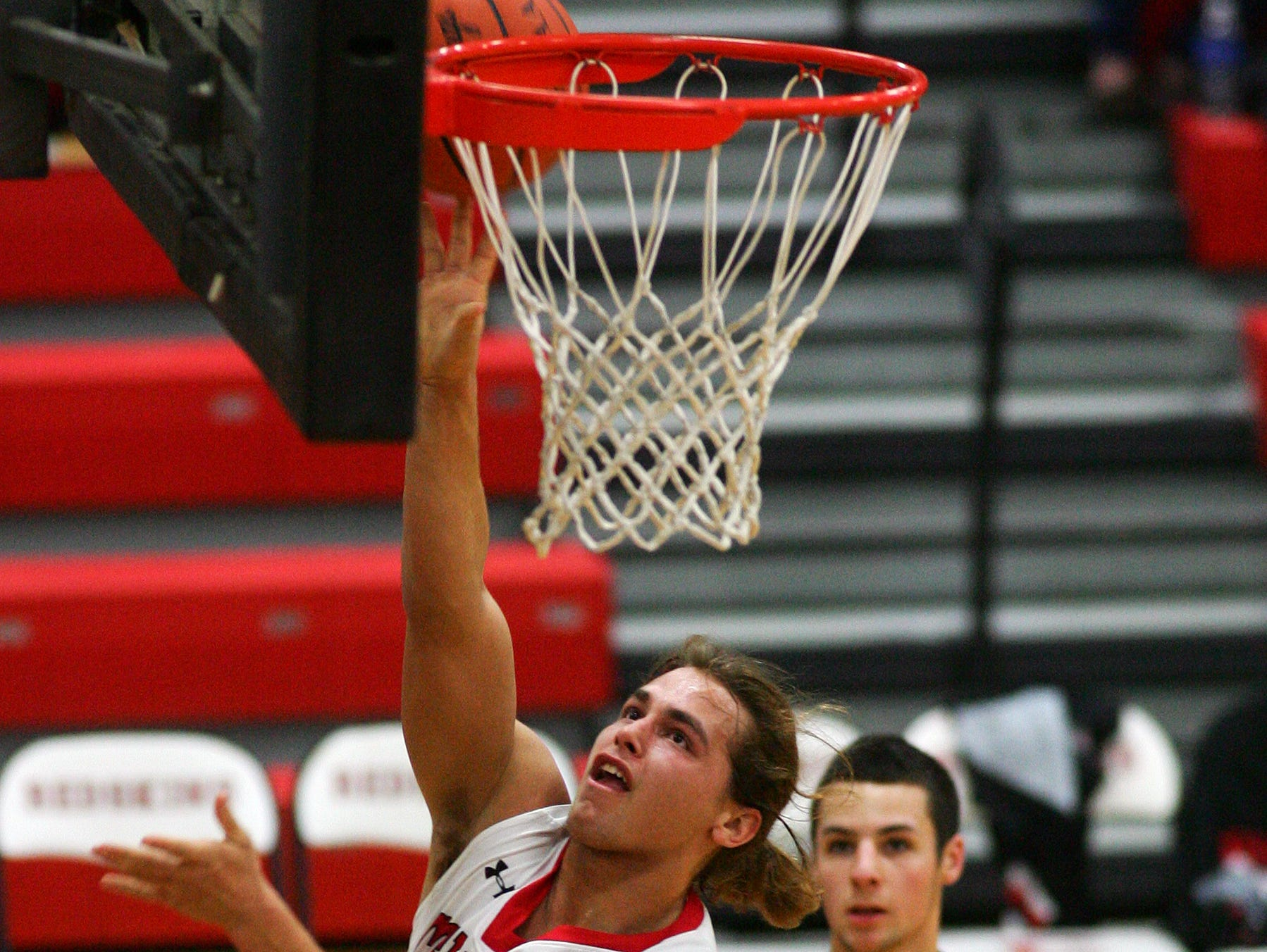 Coshocton junior Dallas Griffiths reaches for the basket Friday during the team's 69-68 loss to Bishop Rosecrans in overtime.