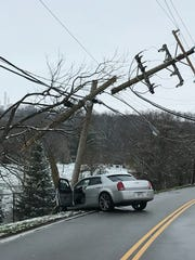 An afternoon crash on Gray Road caused a road closure and a small power outage Saturday afternoon.