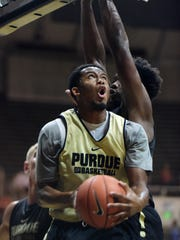 Purdue's Basil Smotherman looks to go up and under Caleb Swanigan for a lay up Saturday, October 24, 2015 at Mackey Arena in West Lafayette.