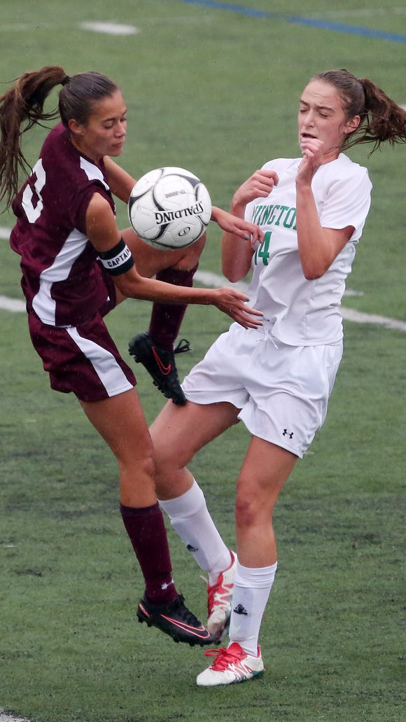 From left, Alberts Magnus' Danielle LaRochelle (3) and Irvington's Jessica Greene (14) battle for ball control during the girls soccer Section final at Arlington High School in Lagrangeville  Oct. 29, 2017. Magnus won the game 3-2.