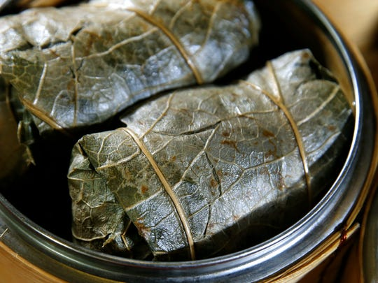 Sticky rice in lotus leaf with chicken and sausage as part of the dim sum menu at Shanghai restaurant.