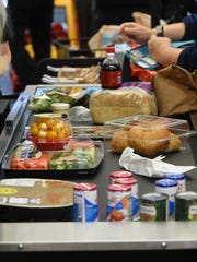 Customers checks out their food items at the new Harps store on Wednesday. The store is holding it's grand opening today.