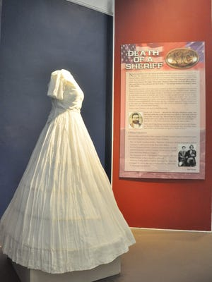 A wedding dress worn during the Civil War era is among the highlights at the Rural Heritage Museum exhibit.
