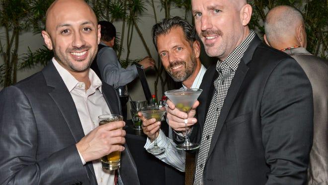 Art Dominguez, James, Meyers, Gregory Hopkins (l-r) enjoying cocktails at Center Stage.