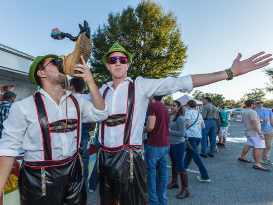 Attendees enjoy the brew at previous Brewfest at the