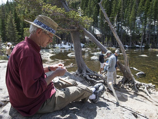 Jeff Kearns ties a nymph on his fly line to target Greenback Cutthroat trout at Dream Lake in Rocky Mountain National Park Wednesday, June 8, 2016.