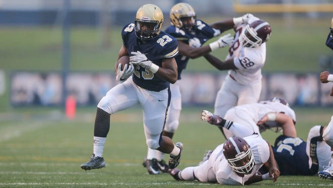 Pearl High School running back Johnny Winston (23) pulls away from a Kosciusko defender. Pearl and Kosciusko played in a pre-season football jamboree at Pearl High School on Friday, August 12, 2016. Photo by Keith Warren