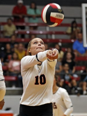 Lubbock-Cooper's McKeely Underwood (10) sets the ball during a home District 3-5A match against Monterey on Sept. 3, 2019, in Woodrow.