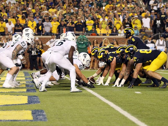 Michigan prepares to snap the ball against the Michigan