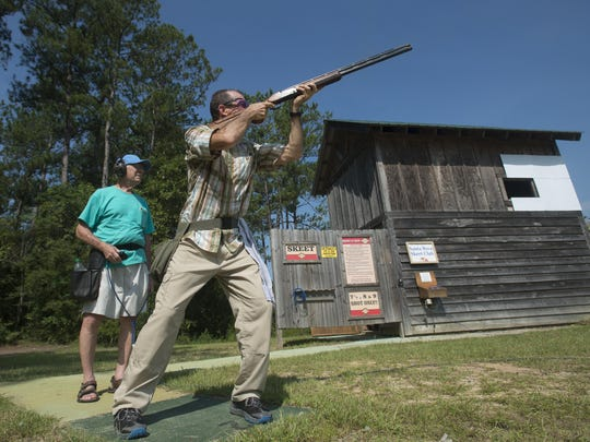 Stan Grossman, right, takes aim at a clay target while Ted Peaden, left, controls the target throwing machine during a meeting of the Santa Rosa Skeet Shooting Club at the Santa Rosa Shooting Center Wednesday.