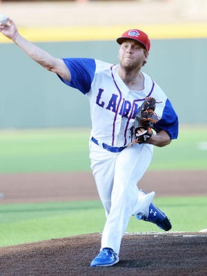 Hays Lark pitcher Wyatt Divis throws against the Kansas City All-Stars, an 18U team, on the opening night of the 76th National Baseball Congress World Series.