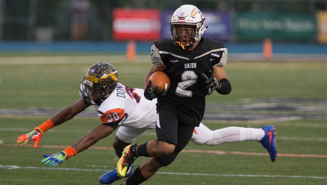 Union's Justin Beckett evades Middlesex's Brevin Donerson during the second quarter of Snapple Bowl XXIV at Kean University in Union on July 20, 2017.