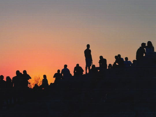 """""""Just look at that,"""" George Stergiopoulos says of this snapshot of people lined up against an orange-red sky near the Parthenon in Athens, Greece."""