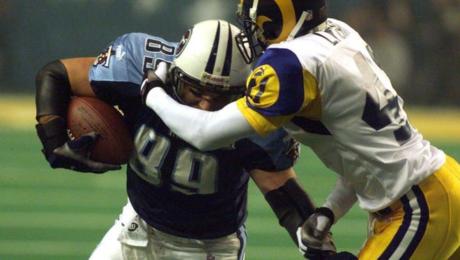 St. Louis Rams defensive back Todd Lyght tackles Titans tight end Frank Wycheck during Super Bowl XXXIV in 2000.