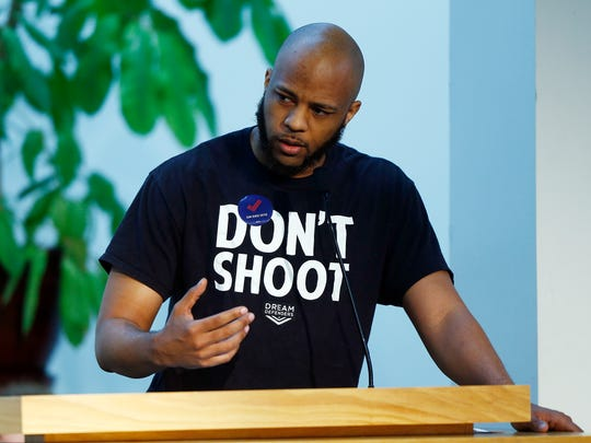 Andre Canty speaks at a vigil to honor the students killed at Marjory Stoneman Douglas High School in Parkland, Florida, and to stand against gun violence Sunday, Feb. 25, 2018, at the Tennessee Valley Unitarian Universalist Church in Knoxville.
