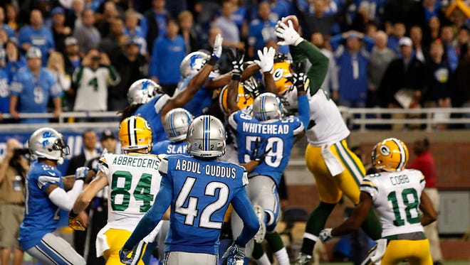 Green Bay's Richard Rodgers reaches up for the ball for a touchdown on a hail Mary pass on a free play after a penalty during the NFL Thursday night football game against the Green Bay Packers on Dec. 3, 2015 in Detroit. The Packers defeated the Lions 27-23.