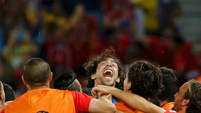Chile's Jorge Valdivia (center) celebrates his goal against Australia with his teammates during their 2014 World Cup Group B soccer match.