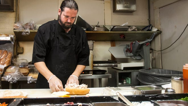 Peasant Village Restaurant and Deli's executive chef Jason Helfer prepares lunch in 2014.