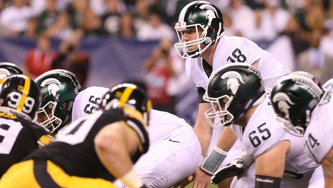 Michigan State runs a pro-style offense, similar to many NFL teams, requiring checks and reads by the quarterback, often playing under center.