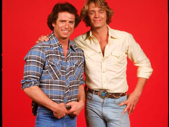 "John Schneider, right, as Bo Duke in ""Dukes of Hazzard,"" which premiered in 1979."