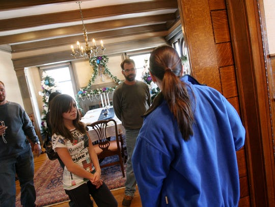 Visitors get a tour of Oakhurst, the former home of