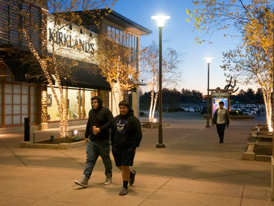 Some shoppers arrive with the sunrise. Shoppers showed up at Freehold Raceway Mall for bargains. Not all stores opened early so crowds were light, but stores with sales were crowded.