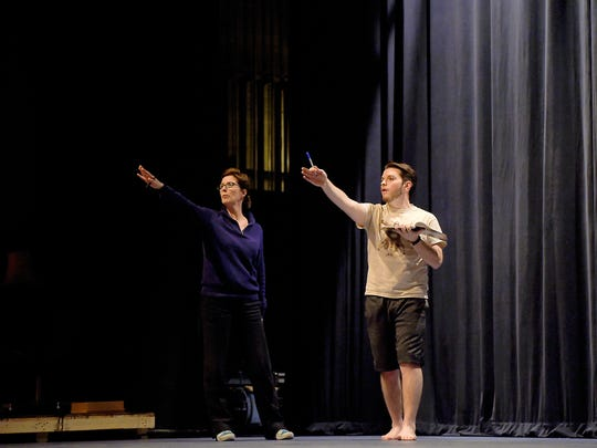"""Professor Elizabeth Mozer works with Binghamton University student Gregory Decola during a rehearsal for """"Castle On The Hill."""" Mozer wrote and directed the play about the Binghamton State Hospital."""