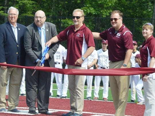 Hawthorne Mayor Richard Goldberg (second from left) cutting ribbon to open new multi-sport turf field at Hawthorne Christian. Joining Goldberg are (from left) Hawthorne Councilman Dominic Mele, Hawthorne Christian School Board Chairman Paul Egedy, athletic director Tyler Van Dyk and former Director of Advancement Tammy Butler.