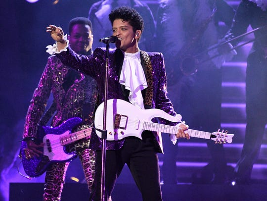 Bruno Mars — clad in full purple regalia pays tribute