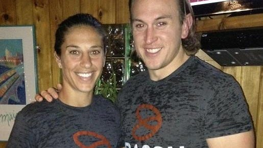 Justin Basch with soccer star Carli Lloyd, one of his Basch Solutions clients.