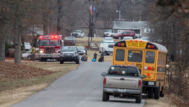 Emergency crews respond to Marshall County High School after a fatal school shooting Tuesday, Jan. 23, 2018, in Benton, Ky. Authorities said a shooting suspect was in custody.