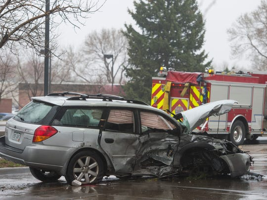 Law enforcement responds to the corner of Eisenhower and Wilson after a crash in Loveland on Friday, March 31, 2017.