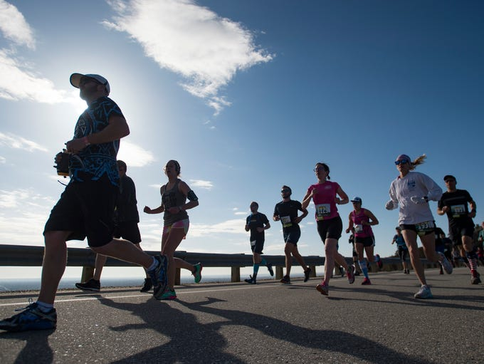 Runners make their way across Dixon Canyon Dam along