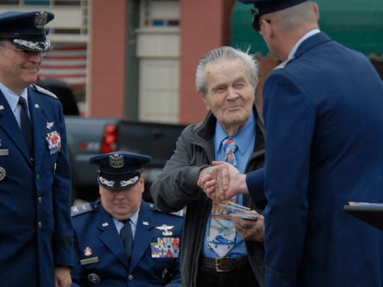 James Fletcher, the only surviving member of Coastal Base Four, shakes hands with Patrick Fulgham, vice commander of the Virginia Wing of the Civil Air Patrol, Saturday, March 12, 2016 in Parksley. Fletcher was promoted to colonel for his service with the Civil Air Patrol Coastal Base Four in Parksley during WWII.
