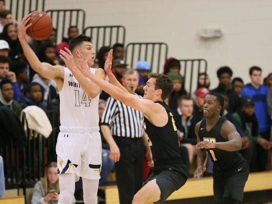 Whitnall's Tyler Herro looks for a way to pass around Brown Deer's Liam McGuire.