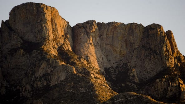 The setting sun lights up the Catalina Mountains at