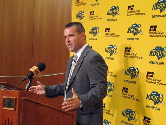 North Dakota State athletic director Matt Larsen speaks at a news conference on Aug. 27, 2015, in Fargo, N.D. Larsen says there is disappointment when they don't play an FBS school because the fans want to see how the Bison stack up.