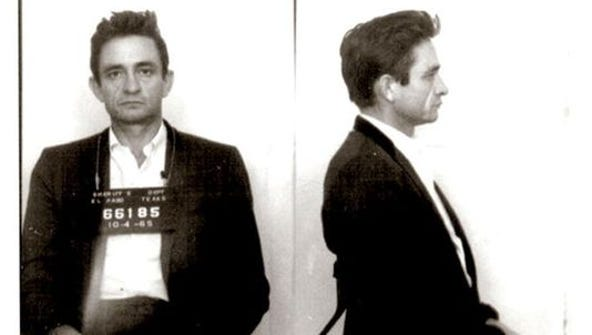 Country singer/songwriter Johnny Cash poses for a mug
