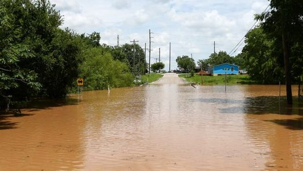 Sixth Street is impassible due to rising flood waters