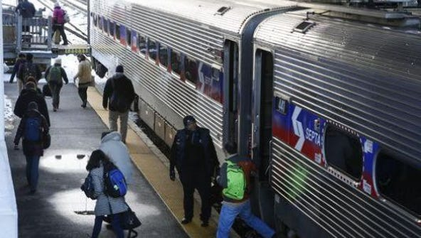 A SEPTA commuter train stops in Newark. Plans to extend